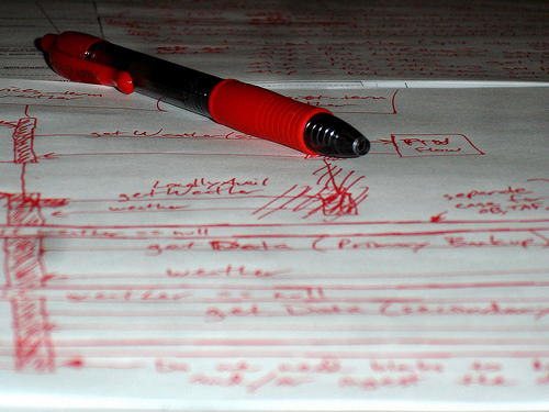 Red pen on paper